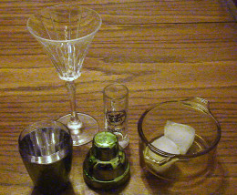 Martini glass, cocktail shaker and ice.