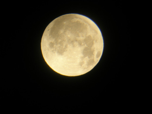 I took this photo with a digital camera, shooting through a telescope aimed at a full moon.