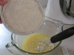 Add your flour mixture to your egg mixture and mix to combine