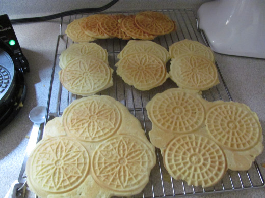 cooling pizzelles, front ones prior to being separated into individual cookies