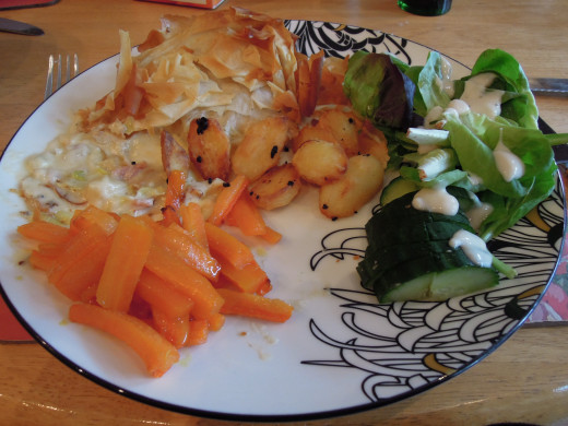 pie with honey and mustard carrots, garlic roasties and salad