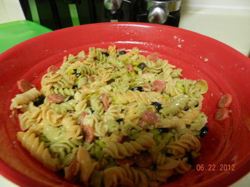 Pasta salad all mixed together.