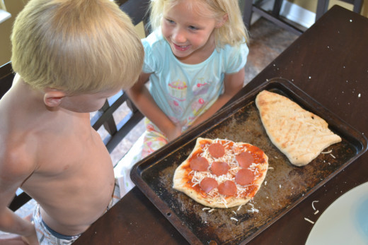 Kids enjoying making pizza