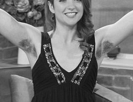 A graduate student from Dublin, UK flaunted her hairy underarms on TV. She challenged the notion that women must be hair-free. Show hosts and audience admired the girl's confidence, however most of them thought that body hair on women was a turn off.