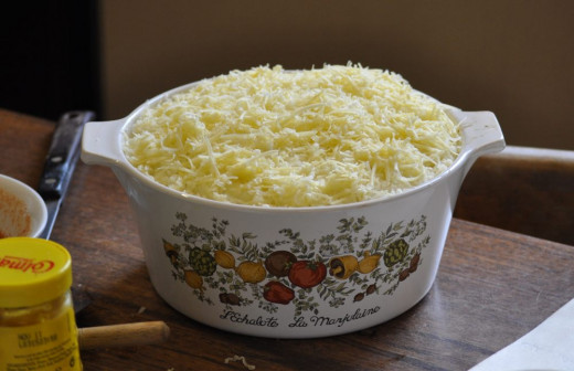 add the grated cheese to the top