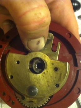 Bridge assembly turned to cover Pinion gear, anti-reverse dog and spring
