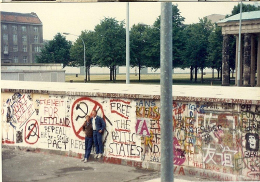 Two friends at the Berlin Wall, 1989.