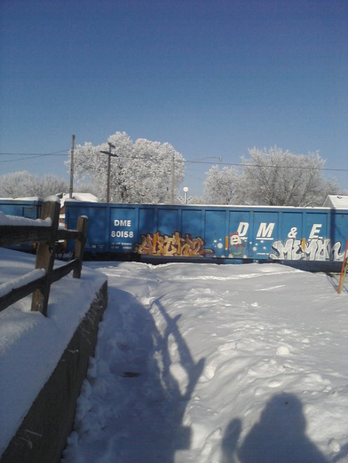 A train sitting by my house in the winter time.