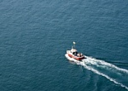 Fishing boat.  I love to ride the waves standing up when going miles out into the ocean.
