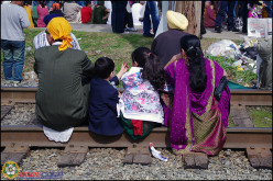 Sitting on a vacated railroad is not illegal and will get you that attention you need.