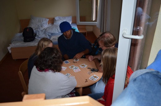 Enjoying a game of cards in a typical hostel room.