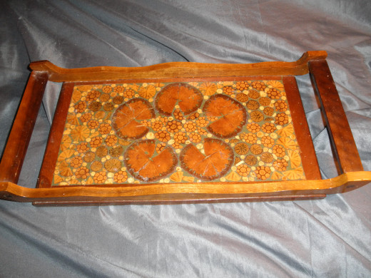 Here's a hand made folk art tray. It was made with lots of little sticks that were cut up and placed vertically to form an interesting pattern.