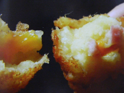 Piping hot potato croquettes with ham and cheese filling