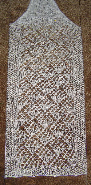 This scarf is also being blocked to hang uniformly.  Without blocking, it can look bunched or gathered.