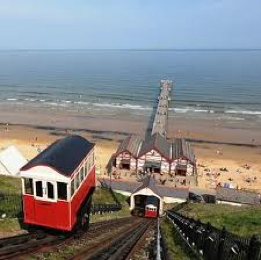 Cliff Lift railway at Saltburn with shortened pier beyond the old amusement arcade