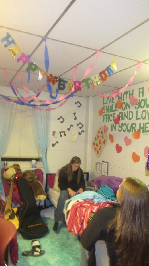 I decorated my roommate's side. A quote with a hearts escaping the jar as well as music notes. The birthday stuff was for me! :)