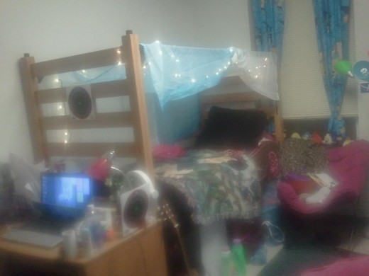 my second room, not during christmas...i took the curtains from freshman year making a canopy and strung the christmas lights through them