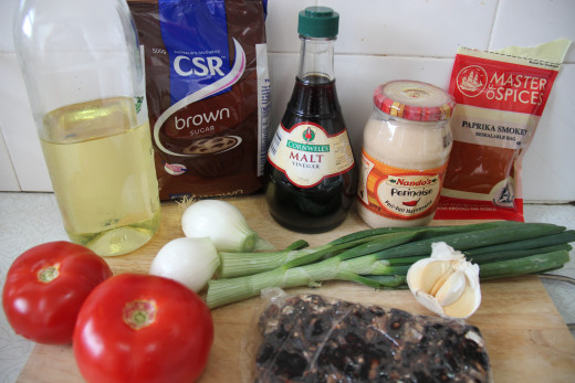 All the ingredients to make braised lamb: Oil, brown sugar, malt vinegar, mayonnaise, spring onions, tomato, tamarind, garlic