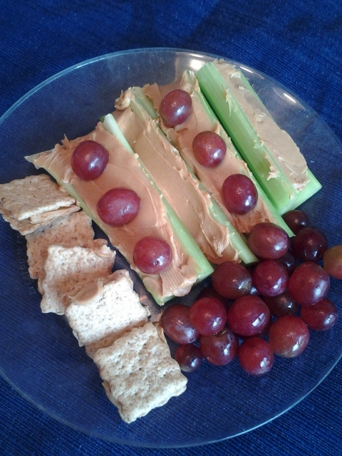 Celery with peanut butter and whole wheat cracker peanut butter sandwiches