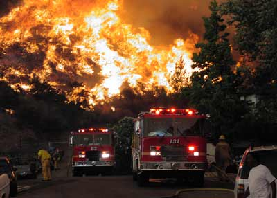 Fire Departments respond to emergencies like brush fires.