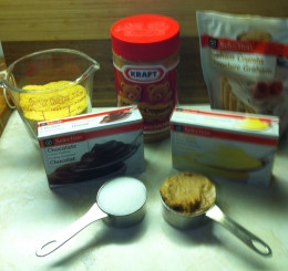 Ingredients for the crust along with 1 box of instant chocolate pudding and one box of instant banana pudding. You won't need the pudding mixes until later in the recipe.