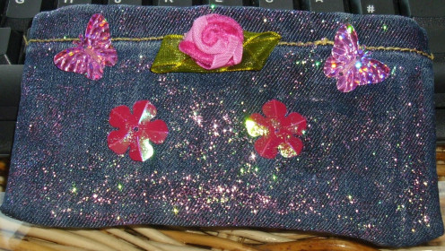 Embroidered cellphone/lipstick  purse for special event.