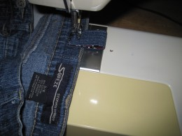 d. Machine stitch ends of tabs below the top of the waistband.
