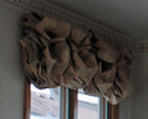 Puffy balloon valances give windows a light and airy feel.