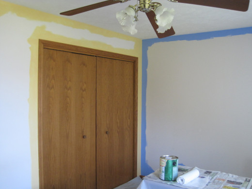 Painting blue and gold trim.