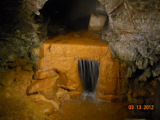 A waterfall (perhaps thousands of years old) still flows inside the Roman Baths museum