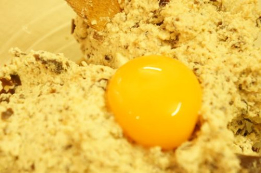 transfer to a bowl, add egg yolk and mix well