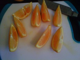 Cut the citrus fruit in half again, and one more time into small sections.