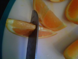 Cut one sliver of fruit 3/4 of the way through to make a garnish for your glass.