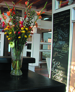 A DIY project as simple as a chalkboard and a vase of fresh flowers brings a bit of cottage into the kitchen.