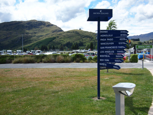 Just outside the airport in Queenstown, the describes where you are located in relation to the cities of the world.