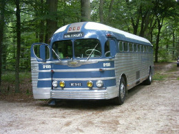 Old-model Greyhound bus.