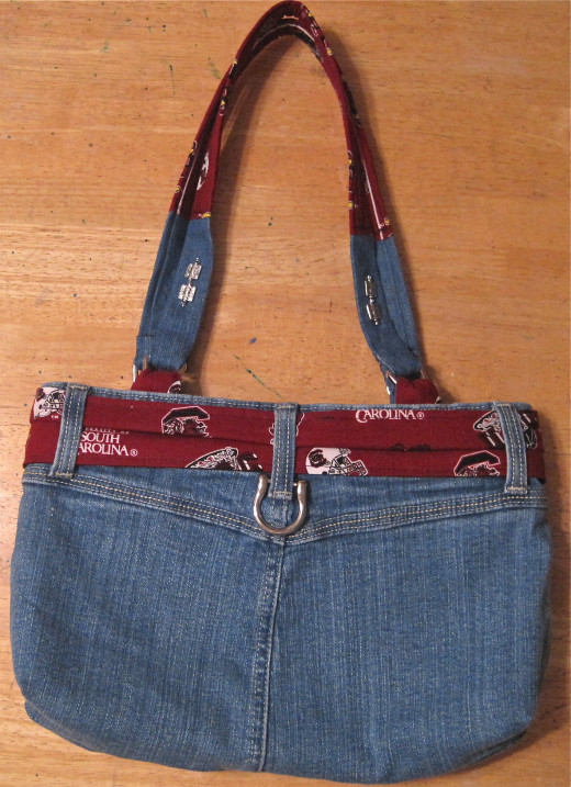 A larger piece of silver handle hardware added a finishing touch to the back of this denim skirt handbag.