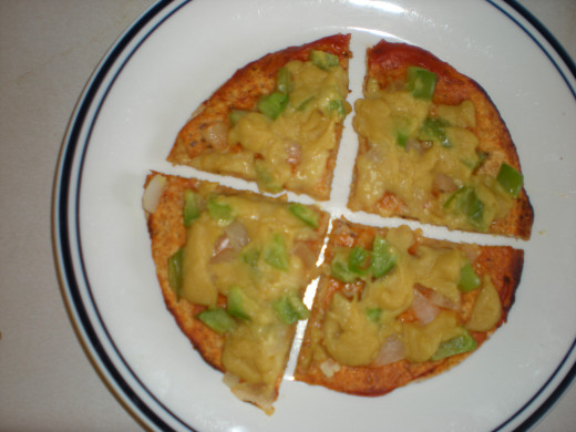 Tortilla Pizza with Nutritional Cheese Sauce on Top