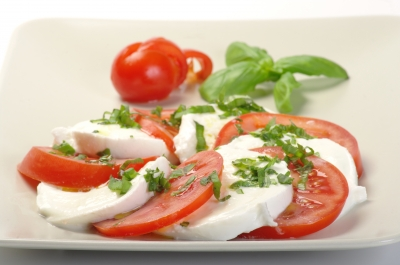 Balsamic vinegar and olive oil are a perfect topping for sliced tomatoes, basil and mozzarella.