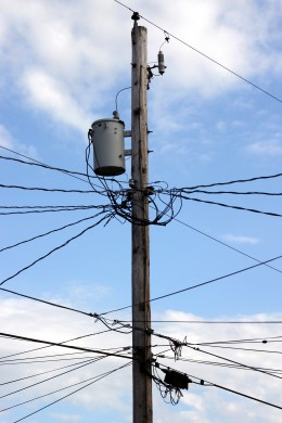 Tangled wires could be from telephone overload. The system overloads with unwanted calls.