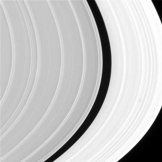 As the Cassini Spacecraft approached Saturn in 2004, it snapped this gorgeous photo of Saturn's rings with the sun directly behind it. You can really tell they're made of ice particles in this photo. (I'm guessing that spot is a moon.)