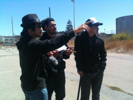Me (in the fedora hat) directing my two actors.