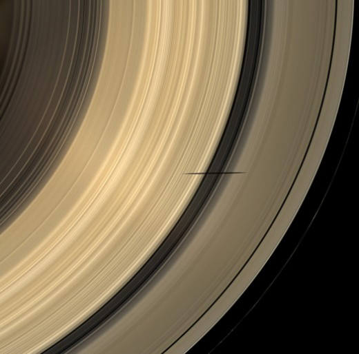 "When Saturn's rings are at just the right angle relative to the Sun, its moons cast long dark shadows as they pass among the rings. Here we see the shadow of the ""Death Star Moon"" Mimas."