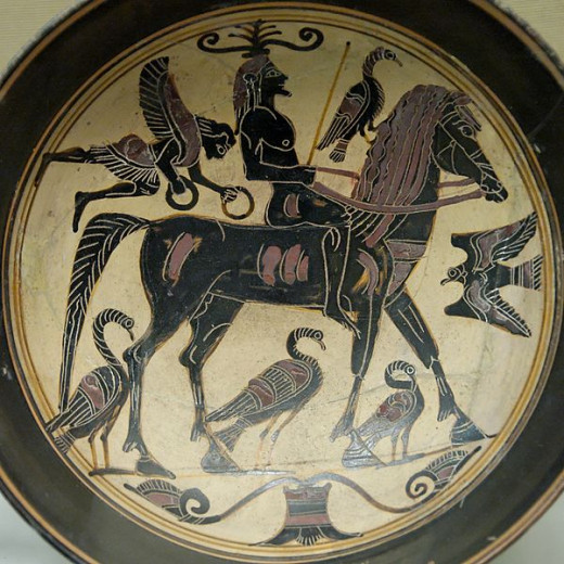 A confident rider, surrounded by birds of good omen is approached by a Nike bearing victor's wreaths on this Laconian black-figured kylix, ca. 550–530 BCE