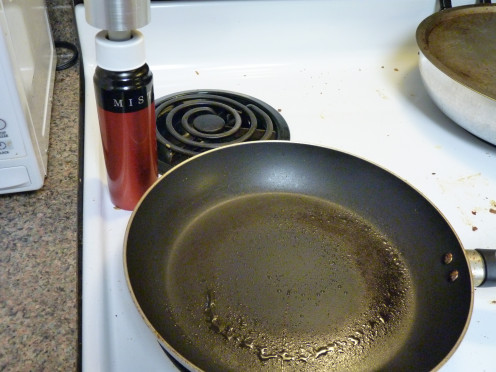 All the while Preheating Pan. Spray w/ Cooking Spray (or use the handy-dandy Misto Olive Oil Sprayer).