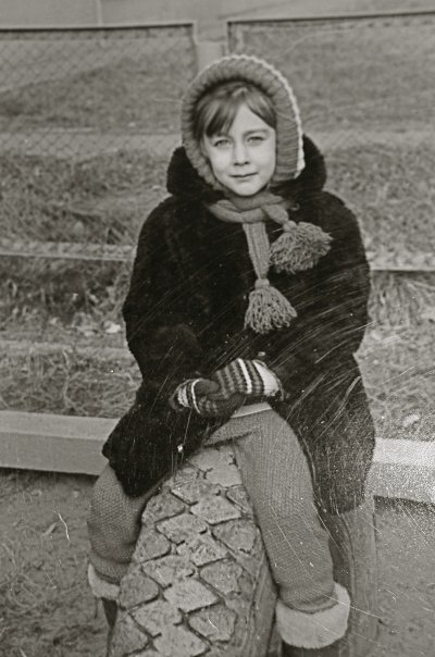 playgrounds with tires, thick winter jacket, and a hat my mother knitted for me