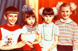 My siblings and I (with a big blue bow). At some point, I wore everything you see in this picture. Every bow, my brother's clown t-shirt, my sister's white dress with green polka dots, and my other sister's striped sweater.