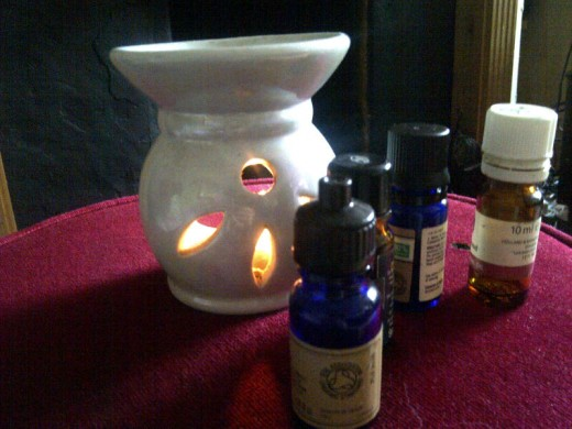 An essential oil burner with oils. Never go to sleep with the burner still alight.