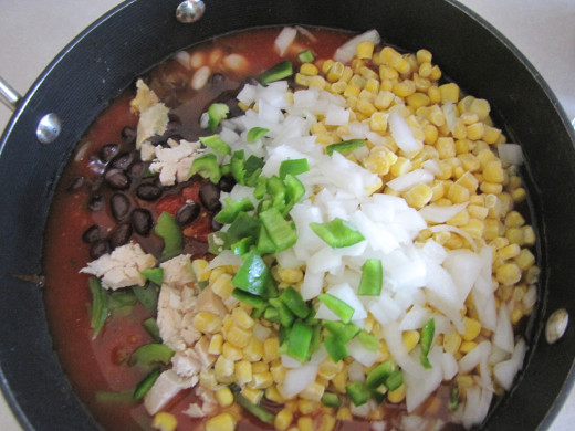Add the the other ingredients: corn, green peppers, onions, beans, meat, etc...