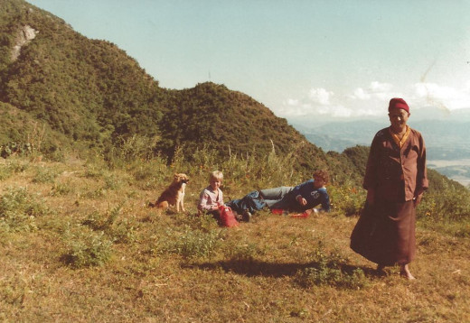 "A mere 3000 meters constitutes a ""hill"" in Nepal. I'm eleven, with a stray dog, my dad and a monk. Business as usual."